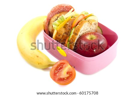 Lunchbox with banana and tomato isolated over white - stock photo