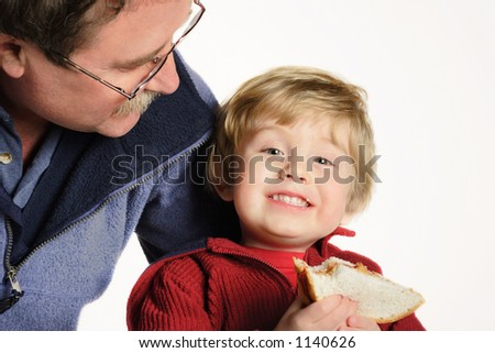 Lunchtime (main focus is on the boy's face) - stock photo