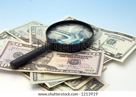 lupe on cash - stock photo