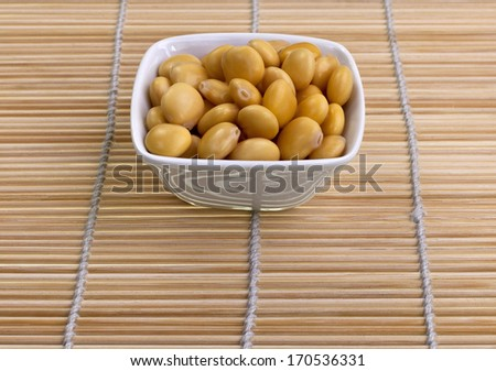 Lupin or Lupini Beans are the yellow legume seeds of Lupinus genus plants, primarily eaten as a pickled snack food.  - stock photo