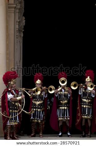 LUQA, MALTA - APR 10- Roman bugles during the Good Friday procesion in Luqa in Malta April 10, 2009 - stock photo