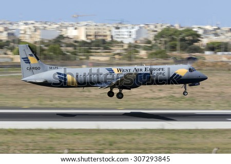 Luqa, Malta August 18, 2015: West Air Europe Cargo British Aerospace ATP landing midfield runway 31. - stock photo
