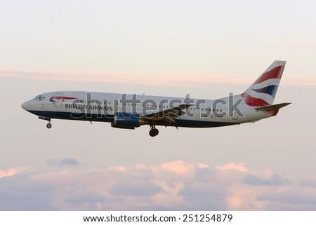Luqa, Malta December 13, 2008: British Airways Boeing 737-436 landing runway 32 just after sunset. - stock photo