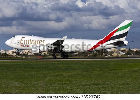 Luqa, Malta December 4, 2014: Emirates SkyCargo (TNT) Boeing 747-4HAF/ER/SCD landing runway 31. - stock photo