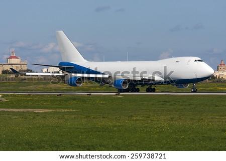 Luqa, Malta February 12, 2012: Boeing 747-2B4BM(SF) backtracking runway 31 for takeoff. - stock photo