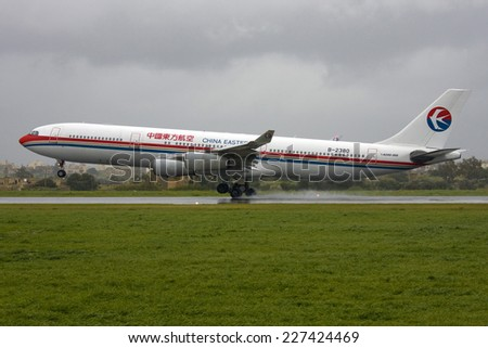 Luqa, Malta February 26, 2011: China Eastern Airlines Airbus A340-313, one of several direct flights from China to Malta to pick Chinese fleeing Libya during the crisis. - stock photo
