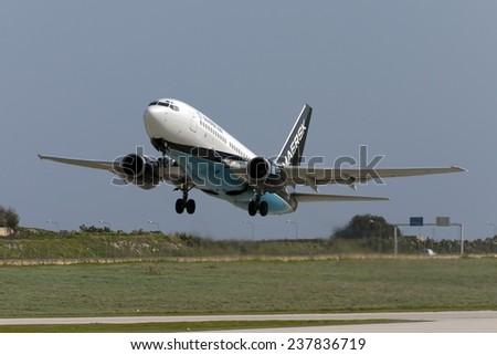Luqa, Malta January 22, 2005: Maersk Air Boeing 737-73S lifts off from runway 32. - stock photo
