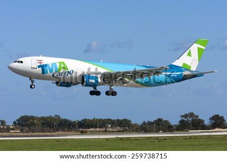 Luqa, Malta January 7, 2012: Trans Mediterranean Airways - TMA Cargo Airbus A300F4-622R landing runway 31. - stock photo