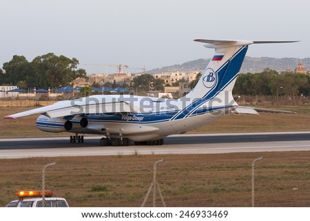 Luqa, Malta July 19, 2008: Volga-Dnepr Airlines Ilyushin Il-76TD-90VD on take off from runway 32 in the very early morning. - stock photo