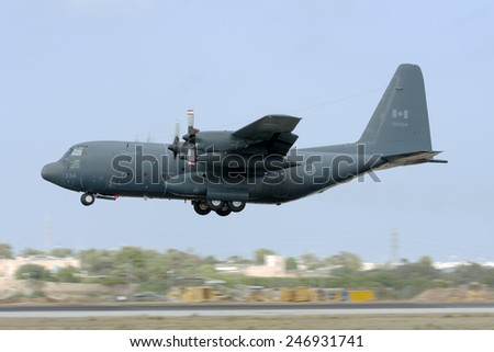 Luqa, Malta June 13, 2008: Canadian Air Force Lockheed CC-130H Hercules (C-130H/L-382) landing runway 31 with number 1 engine shut down and propeller feathered. - stock photo