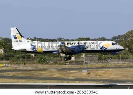 Luqa, Malta June 11, 2015: West Air Sweden Cargo British Aerospace ATP(F) landing runway 31, painted in white instead of the usual silver. - stock photo