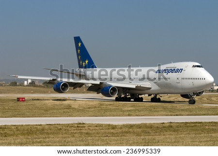 "Luqa, Malta May 1, 2005: European Aircharter - EAL Boeing 747-236B entering apron 9 via taxiway ""Delta"". - stock photo"
