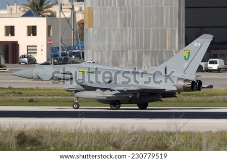Luqa, Malta November 15, 2014: Royal Air Force Eurofighter EF-2000 Typhoon FGR4 backtracking runway 13 to park in apron 4. Arriving with another 2 Typhoons and A330 Voyager.
