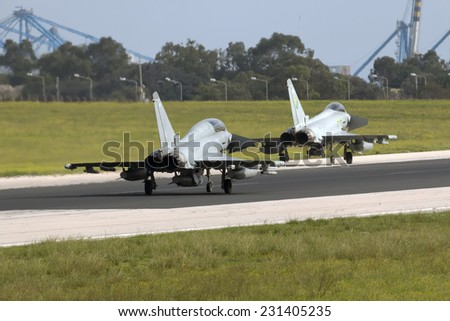 Luqa, Malta November 18, 2014: Royal Air Force Eurofighter EF-2000 Typhoon T3 and Eurofighter EF-2000 Typhoon FGR4 back-tracking runway 31 for departure.