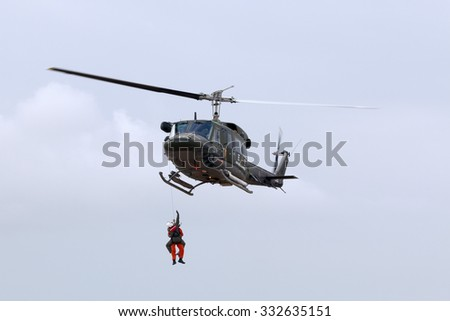 Luqa, Malta September 26, 2014: Italian Air Force Agusta AB-212AM based in Malta performing a rescue demonstration. - stock photo