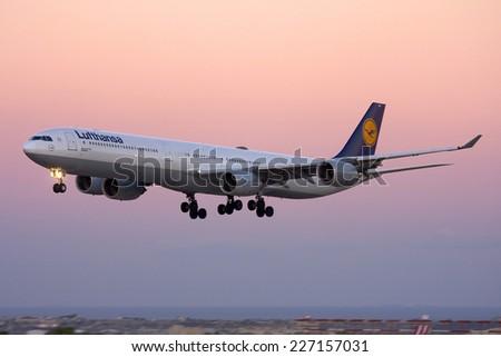 Luqa, Malta  September 12, 2010: Lufthansa Airbus A340-642 landing at dusk for sevricing at Lufthansa Technik Malta (LTM).  - stock photo