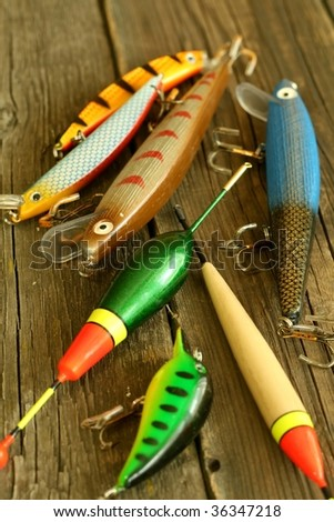 Lures for pike fishing on wooden - stock photo