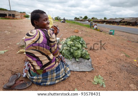 LUSAKA,ZAMBIA – DECEMBER 4:Local woman with her child on the market day on December 3,2011, Lusaka,Zambia. Every Monday there is a huge and colorful market in town. - stock photo
