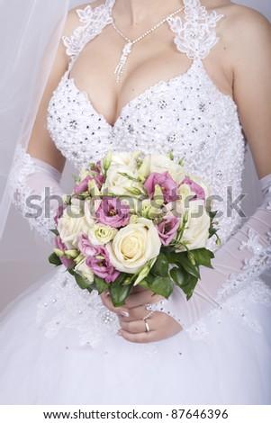 lush bridal bouquet, wedding day, she keeps at chest level. - stock photo