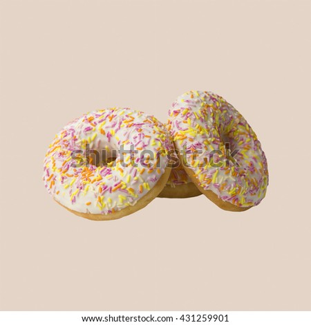 Lush glazed donuts, sweet dish for tea. The dessert of donuts for Breakfast. Tasty food cakes. Delicious classic cakes: fried doughnuts glazed with caramel. Nutritious dish that promotes obesity. - stock photo