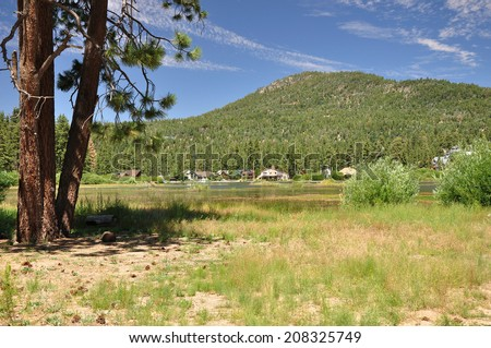 Lush green forests surround the mountain town of Big Bear, California. - stock photo
