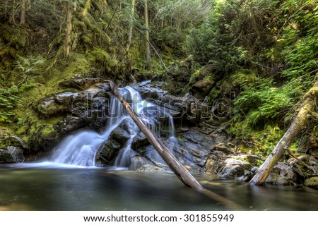 Lush snow creek falls near Kootenai Wildlife Refuge in Bonners Ferry, Idaho. - stock photo
