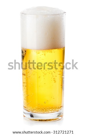 lush white foam in a glass of beer isolated