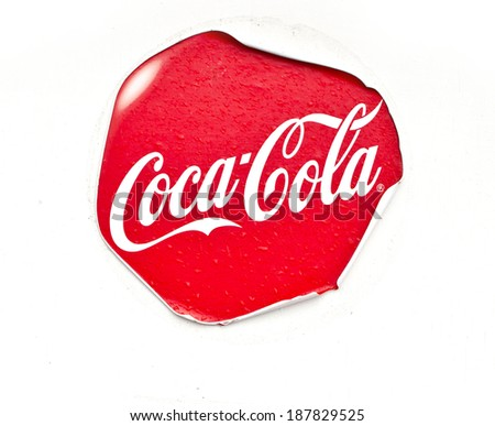 LUSS, UK DECEMBER 27, 2013: photo of Coca-Cola sticker on wall. Based on Interbrand's best global brand 2011, Coca-Cola is the world's most valuable brand. - stock photo