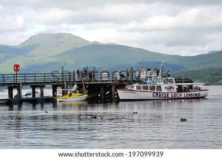 LUSS, UNITED KINGDOM - JULY 15: Boat cruise on Loch Lomond � the largest inland stretch of water in Great Britain on 15 July 2013 in Luss, Scotland, UK.