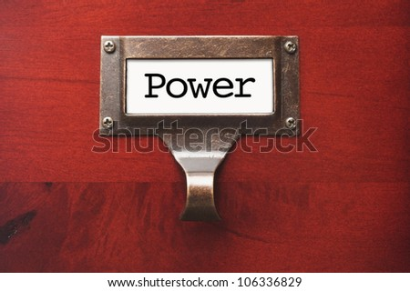 Lustrous Wooden Cabinet with Power File Label in Dramatic Light. - stock photo