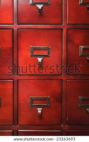 Lustrous Wooden Card File Cabinet in Dramatic LIght - stock photo