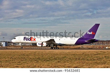 LUTON, ENGLAND - JANUARY 27: A Fedex Boeing 757-204(F) cargo aircraft lands at Luton airport on January 27, 2012 at Luton. A special freighter variant of the passenger 757, it has a range of 3,150nmi