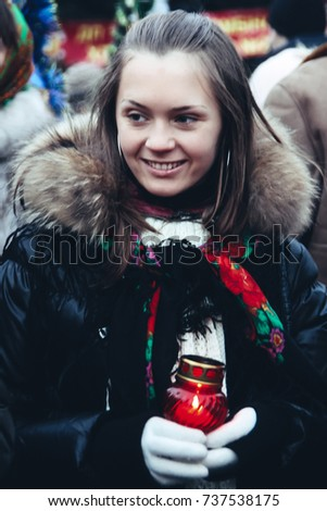 Lutsk, Ukraine - January 11, 2008: Participant of the mass holiday festivities are going in the center of the city during the celebration of Orthodox Christmas