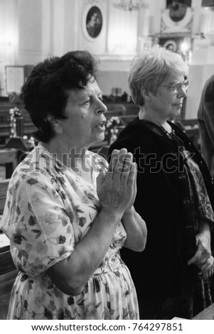 LUTSK, Volyn / UKRAINE - July 26 2009: Old women praying in local church