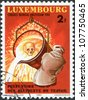 LUXEMBOURG - CIRCA 1980: A stamp printed in Luxembourg, is dedicated to 9th World Congress on Prevention of Occupational Accidents & Diseases, Amsterdam, shows a Worker Pouring Molten Iron, circa 1980 - stock photo