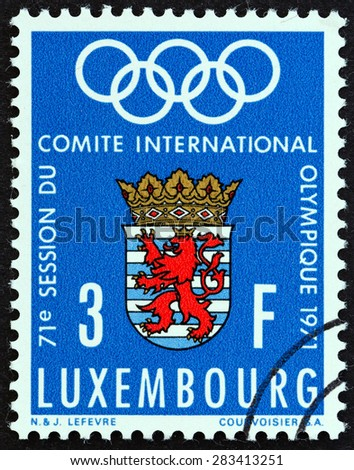 LUXEMBOURG - CIRCA 1971: A stamp printed in Luxembourg issued for the International Olympic Committee meeting, Luxembourg shows Olympic Rings and Arms of Luxembourg, circa 1971.