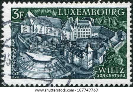 LUXEMBOURG - CIRCA 1969: A stamp printed in Luxembourg, shows Castle and open-air theater, Wiltz, circa 1969 - stock photo