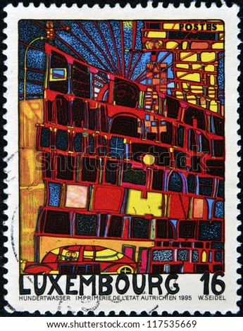 LUXEMBOURG - CIRCA 1995: A stamp printed in Luxembourg shows the House with the Arcades and the Yellow Tower by Hundertwasser, circa 1995