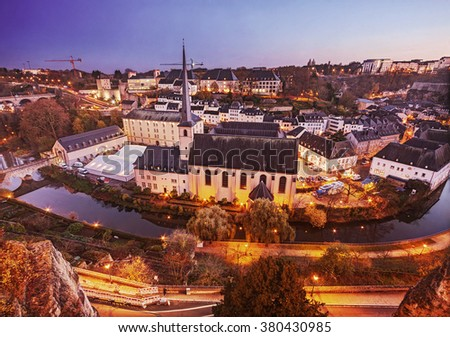 Luxembourg city: aerial view of Saint Jean Baptiste church and Old Town at dusk
