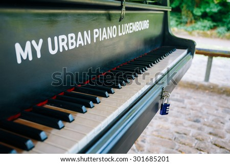 LUXEMBOURG, LUXEMBOURG - JUNE 17, 2015: Urban piano in the city park