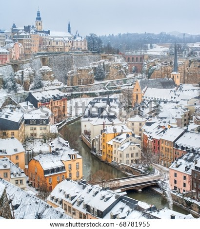 Luxembourg old town panorama on a white winter day - stock photo