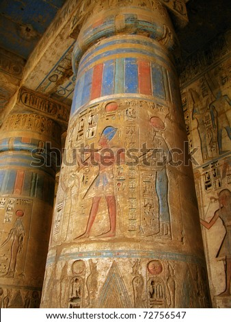 Luxor: polychromed columns with carvings of the pharaoh and his wife surrounded by hieroglyphs, in Medinet Habu temple, dedicated to Ramesses III. Luxor, Egypt - stock photo