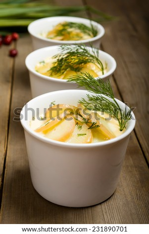 Luxpudding - Swedish food. Baked salmon with potato and greenery - stock photo