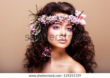 Luxuriant. Femininity. Fashion Model with Classic Wreath of Flowers - stock photo
