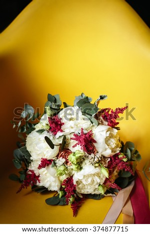 Luxuriant Wedding Bouquet of Different Flowers in Rustic Style on Bright Yellow Background. Empty Space for Text. Selective Focus. - stock photo