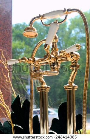 Luxurious and shinny golden faucet in classic style - stock photo