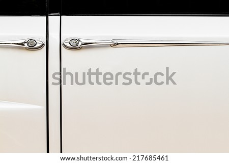 Luxurious and Vintage Beige Car Doors and Handle Detail - stock photo