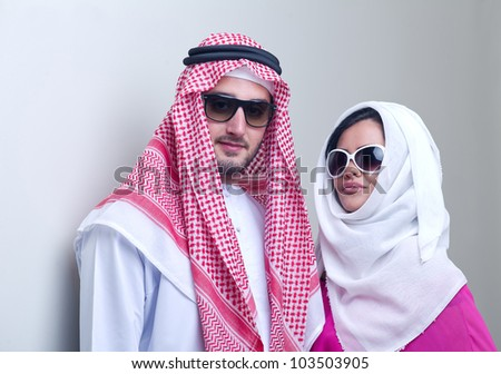 luxurious arabian couple posing - stock photo