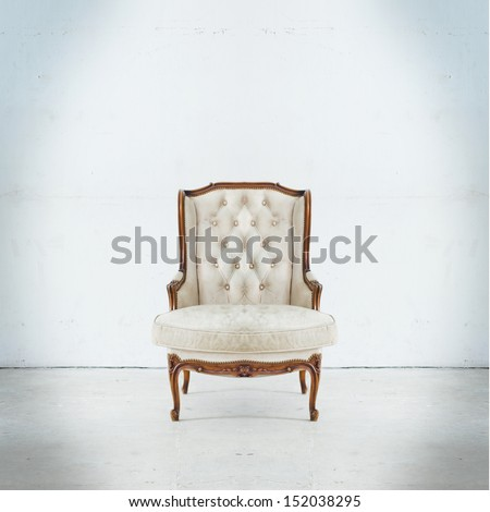 Luxurious armchair in white room - stock photo
