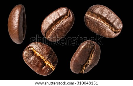 Luxurious aromatic coffee beans on black background - stock photo